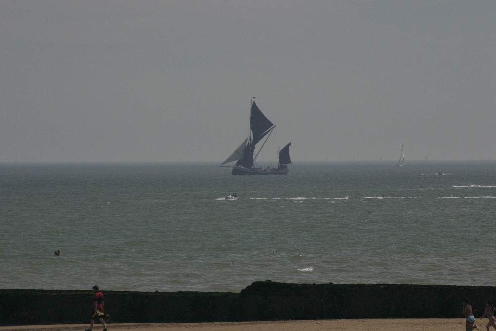 Schooner sailing close into the shore at Clacton-on-Sea